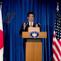 Prime Minister Shinzo Abe speaks during a news conference on the sidelines of the U.N. General Assembly in New York on Wednesday. | AFP-JIJI