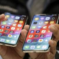 The iPhone XS (left) and XS Max are displayed at a product-release event at Apple's headquarters in Cupertino, California, on Wednesday. | AP