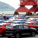 SUVs waiting to be exported are seen at a port in Lianyungang, in China's Jiangsu province, in April.