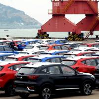 SUVs waiting to be exported are seen at a port in Lianyungang, in China's Jiangsu province, in April. | REUTERS
