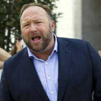 Conspiracy theorist Alex Jones speaks outside of the Dirksen building of Capitol Hill after listening to Facebook COO Sheryl Sandberg and Twitter CEO Jack Dorsey testify before the Senate Intelligence Committee on 'Foreign Influence Operations and Their Use of Social Media Platforms' on Capitol Hill Wednesday in Washington.   AP