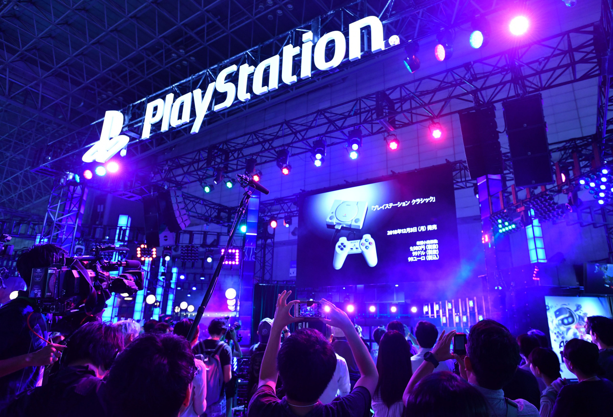 Miniature versions of Sony's original PlayStation game consoles are showcased at a booth at the Tokyo Game Show on Thursday. | YOSHIAKI MIURA
