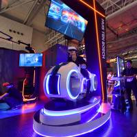 New offerings are displayed to video game fans at the Tokyo Game Show in September last year. | YOSHIAKI MIURA
