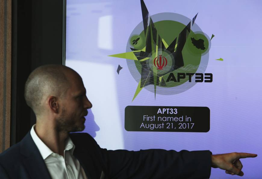 Alister Shepherd, the director of a subsidiary of the cybersecurity firm FireEye, gestures during a presentation about the APT33 hacking group, which his firm suspects are Iranian government-aligned hackers, in Dubai, United Arab Emirates, Tuesday. FireEye warned Tuesday that Iranian government-aligned hackers have stepped up their efforts in the wake of President Donald Trump pulling America from the nuclear deal. | AP