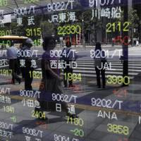 An electronic stock board outside a securities firm in Tokyo | BLOOMBERG