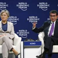 Foreign Minister Taro Kono tells World Economic Forum that Japan is ready to accept more workers from abroad
