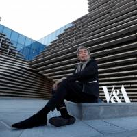Architect Kengo Kuma sits outside the V & A musuem in Dundee, Scotland, Wednesday. | REUTERS