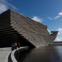 The V & A musuem stands alongside the RRS Discovery in Dundee, Scotland, Wednesday. | REUTERS
