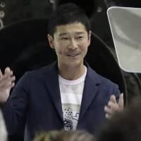 Japanese billionaire Yusaku Maezawa speaks after SpaceX founder and CEO Elon Musk announced in Hawthorne, California, on Monday that Maezawa will be the first private passenger to take a trip around the moon. | AP