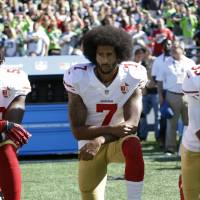 San Francisco 49ers' Colin Kaepernick kneels during the national anthem before an NFL football game against the Seattle Seahawks, in Seattle in 2016. Kaepernick has a new deal with Nike, even though the NFL does not want him. Kaepernick's attorney, Mark Geragos, made the announcement on Twitter, calling the former 49ers quarterback an 'All American Icon' and crediting attorney Ben Meiselas for getting the deal done. | TED S. WARREN / VIA AP