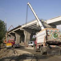 Construction work is in progress in 2017 at a new international trade route, part of a sprawling Chinese initiative to build a 'new Silk Road' of ports, railways and roads to expand trade in a vast arc of countries across Asia, Africa and Europe, near Havalian in Pakistan. | AP
