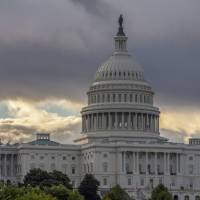 The Capitol in Washington is seen Aug. 1. As a potentially catastrophic hurricane heads for the Carolinas, Congress is moving to avert a legislative disaster that could lead to a partial government shutdown just weeks before the November midterm elections. | AP