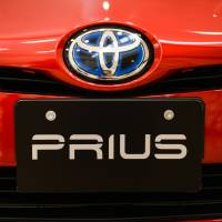 The Toyota Motor Corp. badge is displayed on a Prius hybrid vehicle. The Japanese auto giant has recalled more than 1 million hybrid cars globally due to a technical problem that could cause a fire. | BLOOMBERG