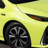 A Toyota Prius plug-in hybrid is seen during a test drive in Tokyo in February 2017. | BLOOMBERG