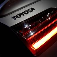 A Toyota Motor Corp. logo is seen on a Corolla model car, made by the firm, in Caracas, Venezuela, in October, 2017. | REUTERS