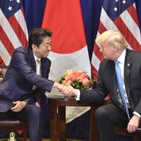 Prime Minister Shinzo Abe meets with U.S. President Donald Trump on the sidelines of the United Nations General Assembly in New York on Wednesday. | AFP-JIJI