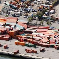 Containers are seen scattered at Rokko Island in Kobe on Wednesday. | KYODO