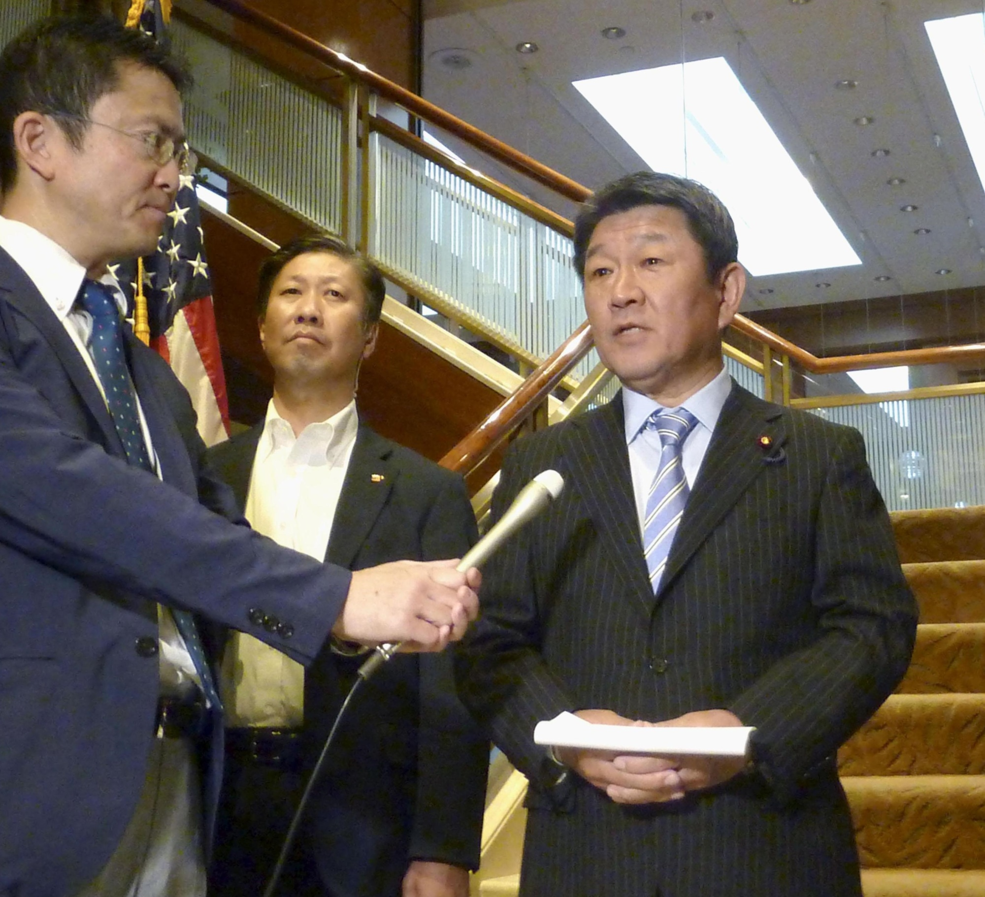 Economic revitalization minister Toshimitsu Motegi answers questions from reporters in New York on Monday.   KYODO