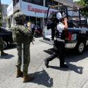 Mexican Marines escort municipal police officers disarmed and detained during an operation to check if they colluded with organised crime, in Acapulco, Mexico, Tuesday.