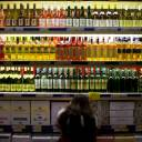 A customer checks bottles of imported wine at a supermarket in Beijing.