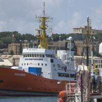 The Aquarius rescue ship enters the harbor of Senglea, Malta, Aug. 15. Spain's maritime rescue service said Sunday that it rescued more than 400 people from 15 small boats, most of them off the country's southern coast, while humanitarian groups lamented that the sole private rescue boat operating near the deadly central Mediterranean human trafficking route risked being put out of action by Italy's anti-migrant leaders. | AP