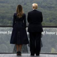 President Donald Trump and first lady Melania Trump stand along the September 11th Flight 93 Memorial, Tuesday in Shanksville, Pennsylvania. | AP
