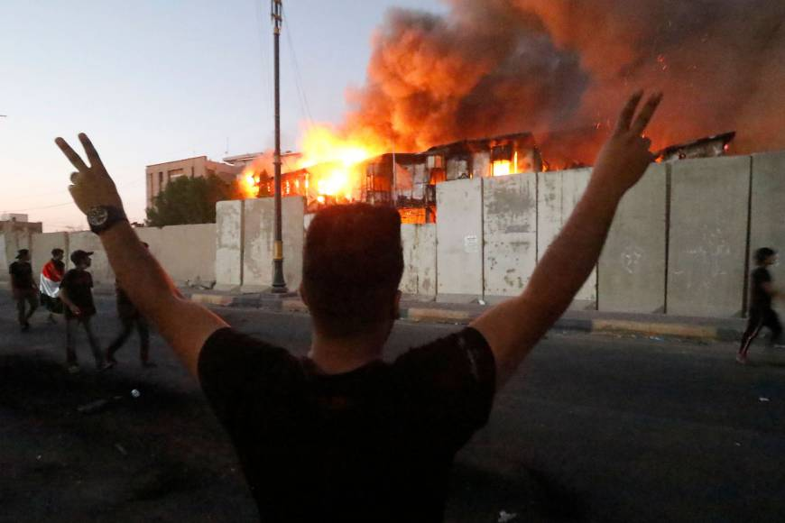 Fires rage in government sites in Iraq's Basra as protesters vent ire