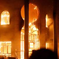 The Iranian Consulate in Basra burns after being torched by protesters during demonstrations over poor public services in Iraq. | AFP-JIJI