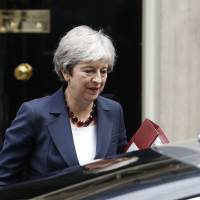 British Prime Minister Theresa May leaves No. 10 Downing St. to head to the House of Commons in London last Wednesday. | AFP-JIJI