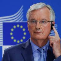 The European Union's chief Brexit negotiator Michel Barnier listens to a translation during a news conference in Brussels in July. | REUTERS