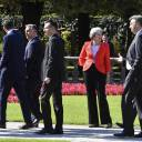 British Prime Minister Theresa May watches other heads of government pass after the family photo at the informal EU summit in Salzburg, Austria, on Thursday.