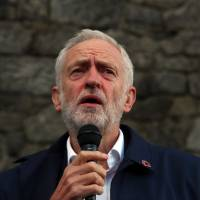 Britain's Labour Party leader Jeremy Corbyn speaks at a vigil for peace in Yemen during the annual party conference held in the northwestern city of Liverpool on Sunday. | REUTERS