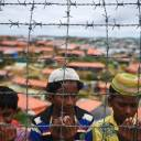"Rohingya refugees perform prayers as they attend a ceremony Aug. 25 organized to remember the first anniversary of a military crackdown that prompted a massive exodus of people from Myanmar to Bangladesh, at the Kutupalong refugee camp in Ukhia. Canadian lawmakers on Thursday unanimously voted to declare Myanmar's military action against the Rohingya people a ""genocide."" The House of Commons endorsed the findings of a U.N. fact-finding mission on Myanmar that found ""crimes against humanity have been committed against the Rohingya"" and that these acts were sanctioned by top Myanmar military commanders."