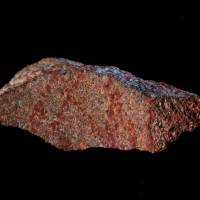 A stone flake discovered in Blombos Cave with red ochre markings that archeologists say represent one of the oldest-known examples of human drawings, on South Africa's southern coast, is shown in this photo released Wednesday. | CRAIG FOSTER / HANDOUT / VIA REUTERS