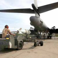 A U.S. Air Force weapons loader delivers a 2,000-oiybd bomb for loading into a B1 bomber at the Diego Garcia base in 2001. International judges will hear arguments on Monday to examine the fate of the Brit.ish-ruled Chagos Islands, home to a strategic joint U.S military base — now claimed by Mauritius. In a diplomatic blow to Britain last year, the United Nations adopted a resolution presented by Mauritius and backed by African countries, asking the International Court of Justice to offer an advisory opinion on the island chain's fate. | U.S. DOD / VIA AFP-JIJI