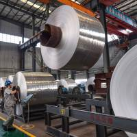 Rolls of sheet aluminum are seen Thursday at a factory in Zouping, in China's Shandong province. | AFP-JIJI