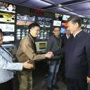 Chinese President Xi Jinping shakes hands with staff members at the control room of China Central Television (CCTV) in Beijing in this Feb. 19, 2016, file photo released by China's Xinhua News Agency.