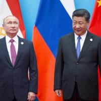 U.S. policy drives Russia and China together ahead of summit