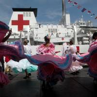 Members of the Chinese People Liberation Army Navy stand at its Peace Ark hospital ship during its arrival ceremony at the port in La Guaira, Venezuela, on Saturday. | REUTERS