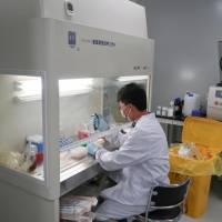 A scientist works at Zai Labo's drug development facility in Shanghai in October 2017. | REUTERS