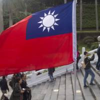 A Taiwanese flag is displayed at the National Palace Museum in Taipei last December. China on Sunday accused Taiwan's spy agencies of stepping up efforts to steal intelligence with the aim of 'infiltration' and 'sabotage,' and warned the island against further damaging already strained cross-strait ties. | BLOOMBERG