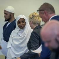 Siraj Ibn Wahhaj (left) and Jany Leveille talk with with attorneys on Aug. 29 in the Taos County Courthouse. | EDDIE MOORE/THE ALBUQUERQUE JOURNAL /POOL/ VIA VIA AP