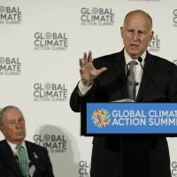 California Gov. Jerry Brown speaks as Michael Bloomberg listens during a news conference at the Global Action Climate Summit Thursday in San Francisco. Gov. Brown started his global climate summit by saying that President Donald Trump will likely be remembered as a liar and fool when it comes to the environment. The Democratic Brown and former New York City Mayor Bloomberg held a press conference Thursday on the first full day of the summit that is partly a rebuke of the Trump administration. | AP