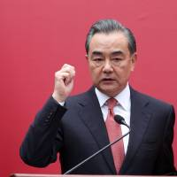 China's Foreign Minister Wang Yi speaks during the opening of a new Chinese Embassy in the Dominican Republic in Santo Domingo on Sept. 21. | REUTERS