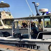 Mohave County Sheriff's Office search and rescue boats look for four people missing on the Colorado River, north of Lake Havasu in Arizona Sunday. | MOHAVE COUNTY SHERIFF'S OFFICE / HANDOUT / VIA REUTERS