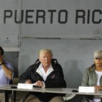 President Donald Trump talks about recovery efforts after he and first lady Melania Trump arrived at Luis Muniz Air National Guard Base to survey hurricane damage in San Juan last October as Puerto Rico Gov. Ricardo Rosselló listens. Trump loves to cite stats, numbers to bolster his political standing. He just doesn't seem to care much about whether they're true. | AP