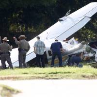 One injured after DEA plane crashes on suburban Houston street