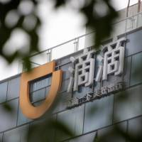 The logo of Didi Chuxing is seen at its headquarters in Beijing on Tuesday. | REUTERS