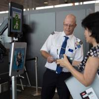 A woman boarding an SAS flight to Copenhagen goes through the VeriScan facial recognition verification system at Dulles International Airport in Dulles, Virginia, on Thursday. | AFP-JIJI