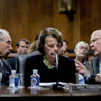 Senate Judiciary Committee Chairman Chuck Grassley, R-Iowa (left), accompanied by Sen. Dianne Feinstein, D-Calif., the ranking member, speaks with Sen. Patrick Leahy, D-Vt., during a Senate Judiciary Committee markup meeting on Capitol Hill Thursday in Washington. | AP